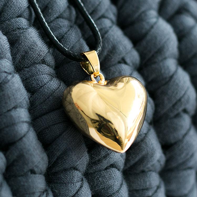 Llamador de angeles corazón dorado